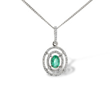 Emerald and Diamond Double Halo Pendant