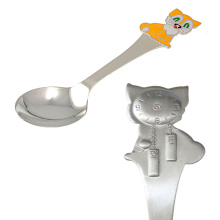 Silver Baby Dessert Size Spoon. Yellow Kitten And A Wall Clock