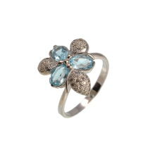 Floral Motif Blue Topaz and CZ Ring. 585 (14kt) White Gold