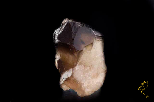 A natural smokey quartz druzy before a carving master  from Golden Flamingo Jewelers starts his work