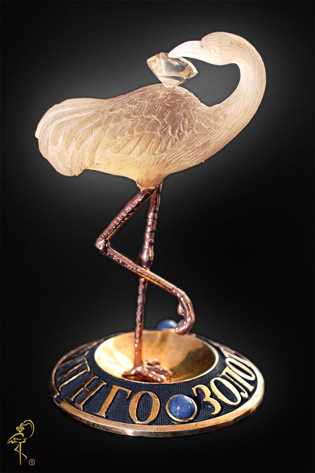 Carving Museum: Golden Flamingo's carved logo